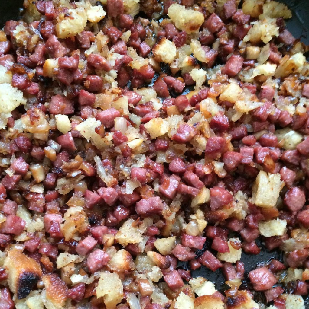 Sausage, onions and mushrooms cooked with homemade challah croutons ready to get stuffed in mushrooms!
