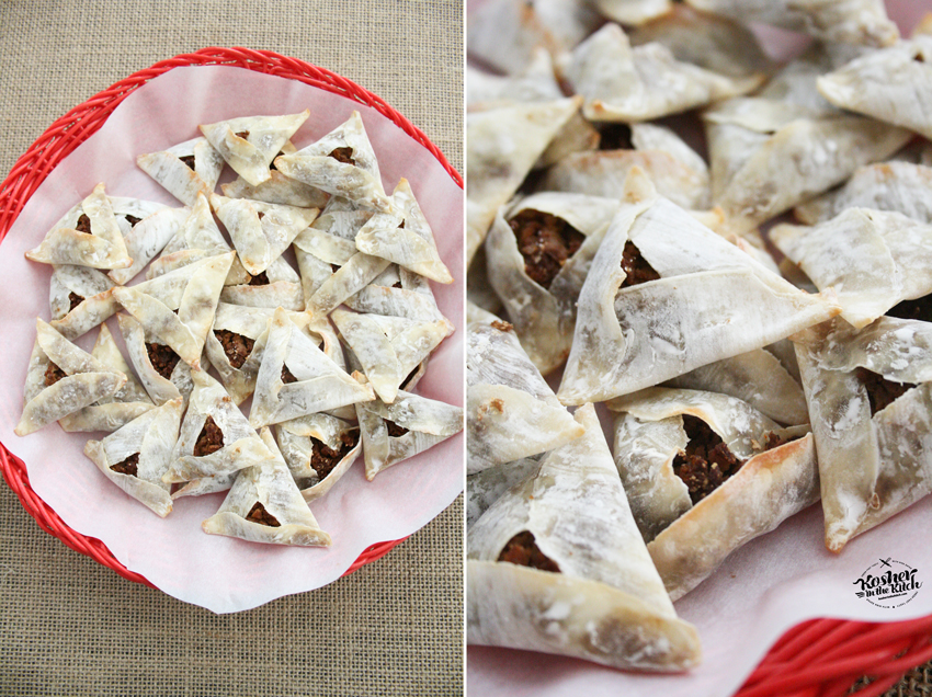 Layer baked nacho hamantaschen on a platter lined with parchment paper