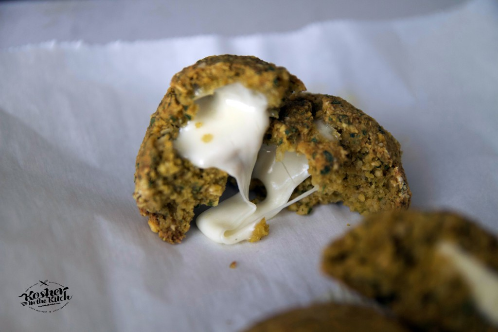 Falafel balls stuffed with mozzarella, baked