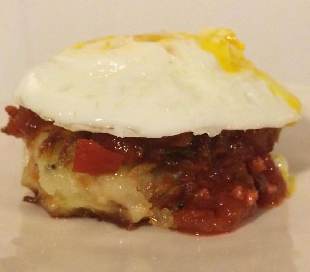 Shakshuka latkes with fried egg