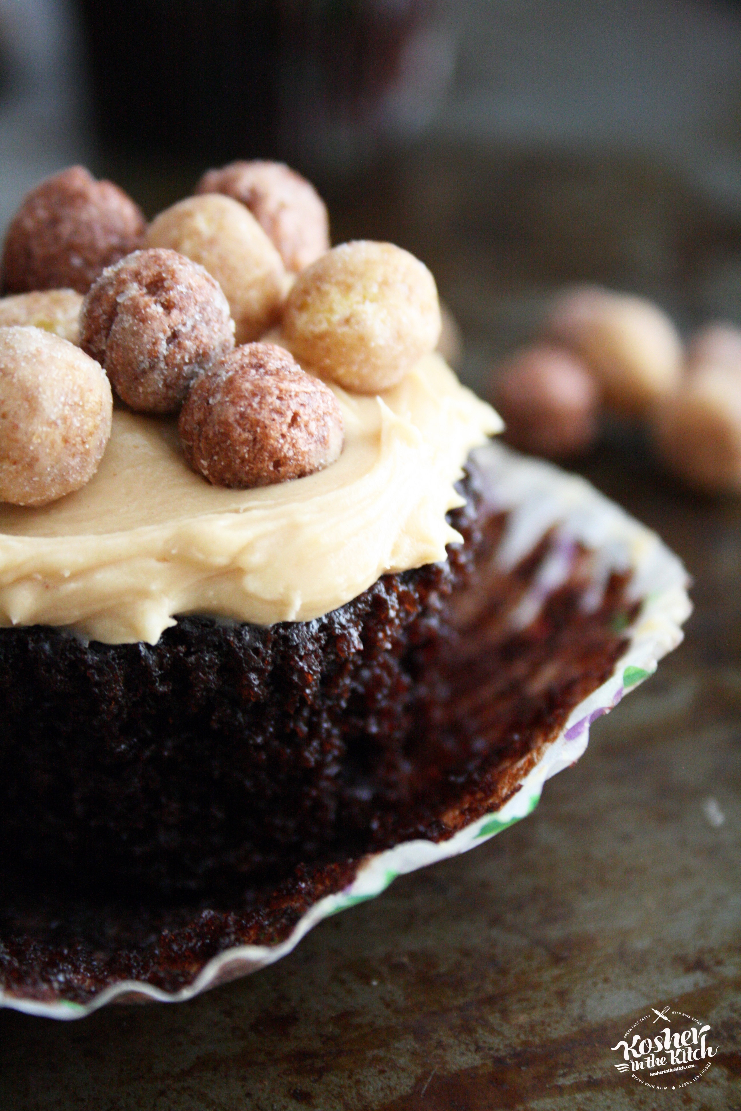 Chocolate Cupcake with Peanut Butter Frosting topped with Reese's Puffs Cereal