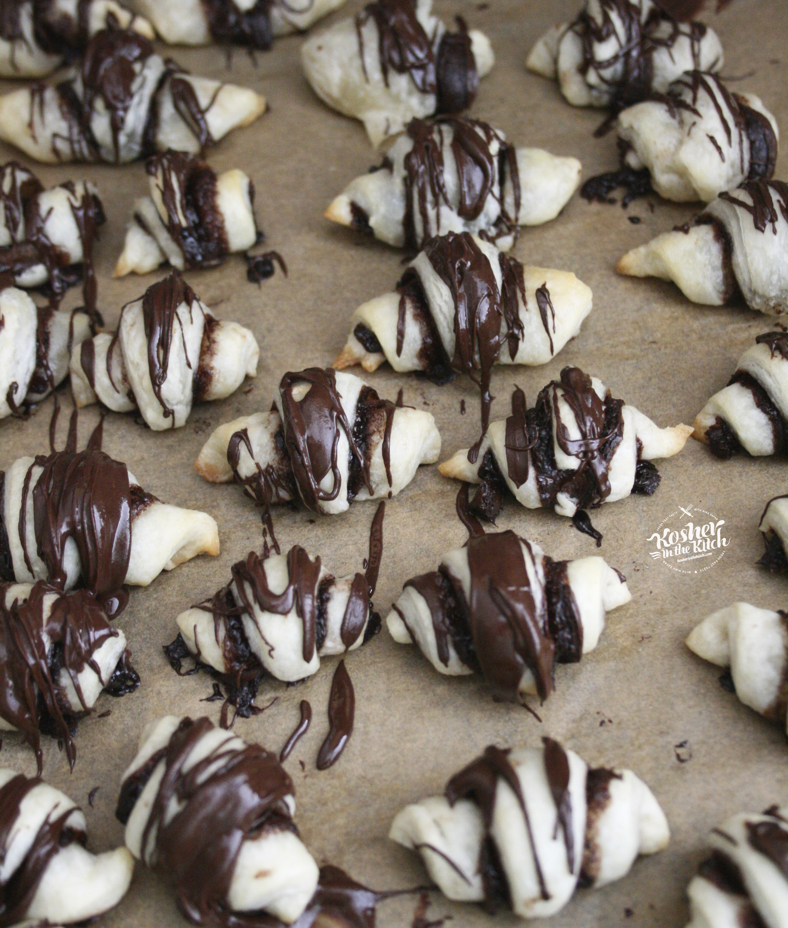 Chocolate Rugelach with Chocolate Drizzled on Top