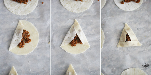 Wet all corners with water then fold left side over, then right side and last bring bottom over sealing the triangle.